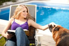 young beautiful woman playing with dog - stock photo