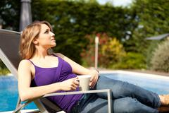 Stock Photo of young beautiful woman drinking coffee