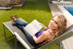 Young beautiful woman reading a book Stock Photos