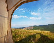 tent on grassland - stock photo