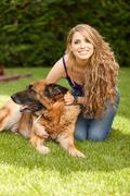 Young beautiful woman playing with dog Stock Photos
