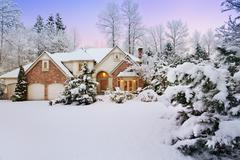 Twilight over snowy home Stock Photos
