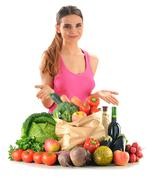young woman with groceries and shopping bag isolated on white - stock photo