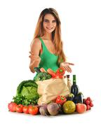 Young woman with groceries and shopping bag isolated on white Stock Photos