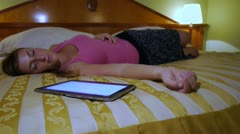 DOLLY: Young woman fell asleep after using her digital tablet Stock Footage