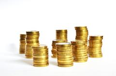 Golden coin piles Stock Photos