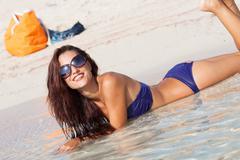 sexy beautiful model laying. having fun on shore - stock photo