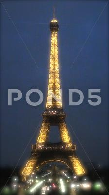 Stock photo of  Eiffel Tower glows at night