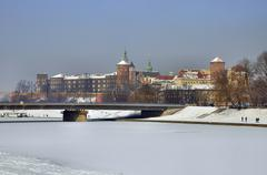Wawel castle and frozen vistula river in krakow Stock Photos