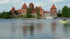 Stock Video Footage of people recreate water transport bicicle on lake in trakai