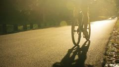 Riding on bike and jogging on the road. Stock Footage