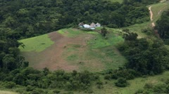 Rural African huts surrounded by forest Stock Footage