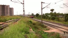 Indian passenger train passes by suburbs of Bangalore, Karnatak Stock Footage
