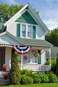 Old farmhouse with flag bunting - stock photo