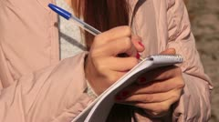 A young journalist takes notes - stock footage