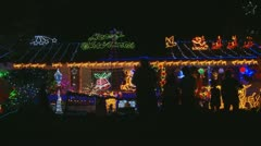 Christmas lights on a house (6) more people gather - stock footage