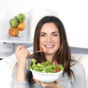 Stock Photo of girl eating healthy food