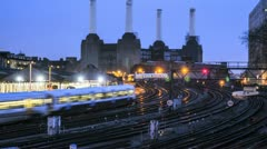 Timelapse Trains wizz past Battersea Power Station an Iconic London landmark Stock Footage