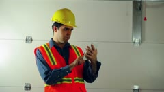 Touchpad construction guy foreman Stock Footage