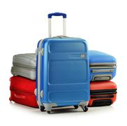 Luggage consisting of polycarbonate suitcases isolated on white Stock Photos