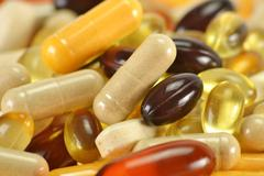 composition with dietary supplement capsules. variety of drug pi - stock photo