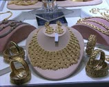 DUBAI gold jewelry zoom in and bokeh effect Stock Footage
