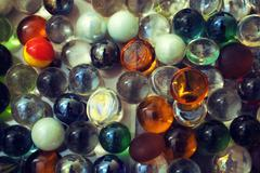 Background with transparent colored glass beads Stock Photos