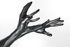 Beautiful men metal hands with long fingers Stock Photos