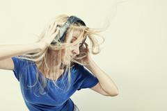 Young woman singing with headphones Stock Photos