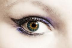 female eye with make-up macro - stock photo