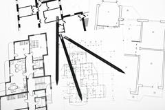 plans for residential flats with pencil - stock photo