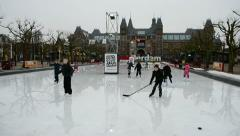 Amsterdam, children on the ice near Rijksmuseum in Amsterdam, Netherlands, Stock Footage