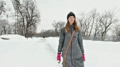 The winter girl in city park walking. Stabilized shot Stock Footage