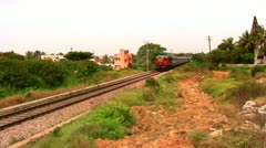 Indian passenger train passes by suburbs of Bangalore, Karnataka, India. Stock Footage
