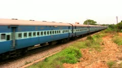 Indian passenger train passes by suburbs of Bangalore, Karnataka, India. Stock Footage