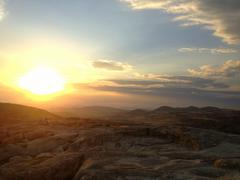 Sunset over stone mountain. Stock Photos