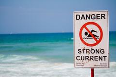 Danger strong current warning sign - stock photo