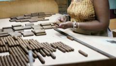 African american woman working in cigar factory in Havana, Cuba Stock Footage