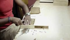African american worker in cigar factory in Havana, Cuba Stock Footage