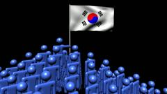 Zooming out from pyramid of men with rippling South Korean flag animation Stock Footage