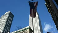US Flag Waving in Front of Empire State Building Stock Video Stock Footage