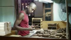 People and industry, manual worker in cigar factory in Havana, Cuba Stock Footage