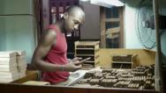 People and industry, manual worker in cigar factory in Havana, Cuba Stock Footage