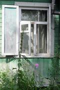 Open window of shabby country house Stock Photos