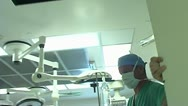 Stock Video Footage of Patient point of view being wheeled into the operating room