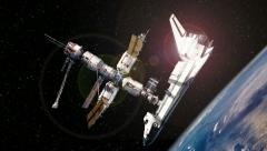 Space Shuttle docked with International Space Station above Earth Stock Footage