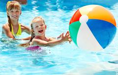 Kids  swimming in pool. Stock Photos