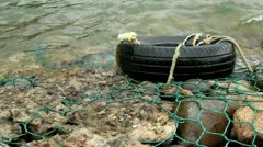 Tire in the water Stock Footage