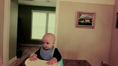Mother feeding baby smoothie Stock Footage