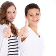 happy teenagers giving a thumbs up - stock photo